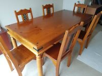 dining table and 6 chairs with unusual detail