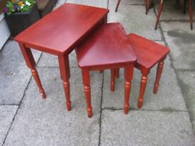 Lovely red coloured wooden nest of 3 tables