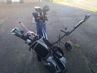Two sets of golf clubs for sale with trolley !