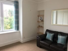 Bright and tasteful fully furnished top floor flat available October for short or long term rental.