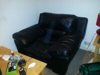 Big one seater black leather sofa
