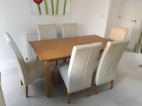 Oak dinning table with 6 leather chairs