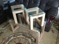 Beautiful 3 piece wooden and glass coffee table set