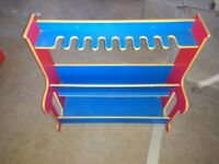 Blue and red wooden musical instruments stand