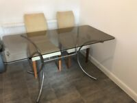 Glass dining table and 4 cream chairs
