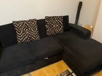 Three Seater Fabric Corner Sofa with 5 cushions. Also comes with 2 black throws