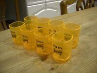 Cointreau plastic Shot glasses x 8. 'Glow with Cointreau'. Florescent. Nice. H 6.5 x W 4.5 cm. Bar