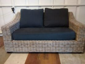 2 Wicker Conservatory Sofas, charcoal grey cushions. Originally from NEXT