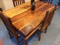 Indian dark wood dining table & 4 chairs.
