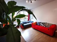 Modern interior 2 double bedroom ground floor flat with a private garden on Mile End Road E3