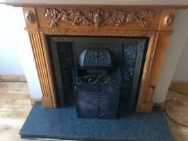 Wooden fireplace surround and insert.