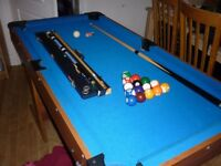 Pool table 5ft,good condition with all accessories,folds flat against wall for storage