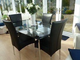 Harvey's Boat Glass Dining Table and Four Matching Chairs