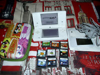 Nintendo DSi and 9 games with carry case and charger