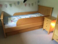 Natural beech children's furniture including single bed, truckle bed, bedside table and wardrobe