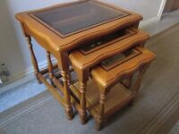 Nest of three glass-top occasional tables