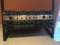 Rack mounted audio hardware . Headphone mixer . Compressor . x2 Audio interface