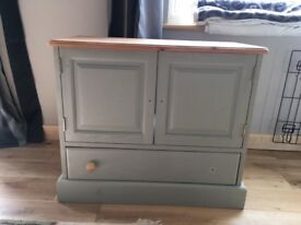Tv cabinet refuebished in a light green