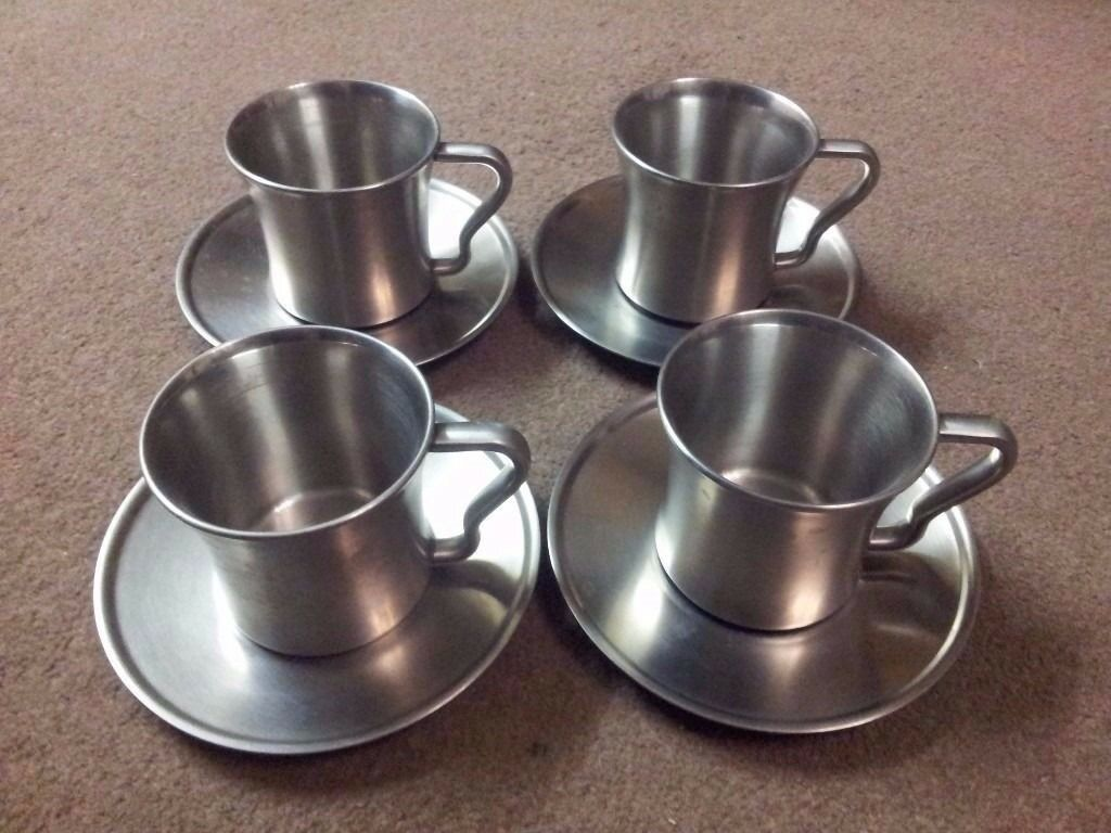 Set of Four Metal Cups and Saucers