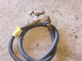 flexible gas pipe with self sealing coupling .