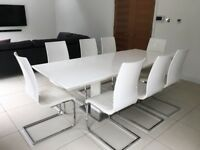 White gloss dining table (pedestal base & extendable) & 8 white gloss/faux leather dining chairs