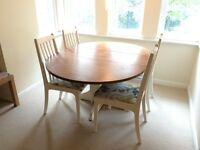 Hand painted extending dining table and 4 chairs.
