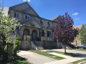 MODERN MULTI-LEVEL 4 Bedroom Townhouse Walk to UWO/Downtown