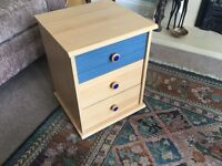 Light Coloured Three Drawer Chest of Drawers / Bedside Table with one Blue Drawer and Blue Handles