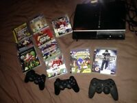 PlayStation 3 with remotes & games