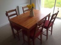 Ikea dining table with 4 matching chairs and seat cushions