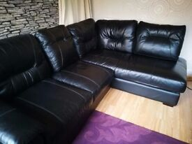 Black leather corner sofa / Can help with delivery if needed