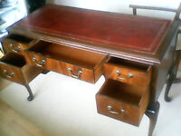 Beautiful wooden desk with leather style top surface