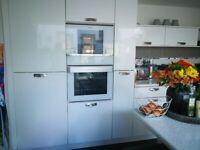 White gloss kitchen Units