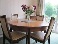G plan teak extending table and 4 chairs ,in very good condition, upholstered chairs.