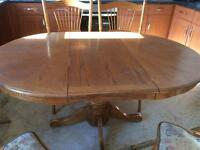 Dining table and 4 chairs. Solid wood and heavy
