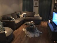 3 Seater Grey corner sofa with double sofa bed and foot stool