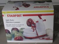 Starfrit apple peeler. Gadget to cut in wedges included.