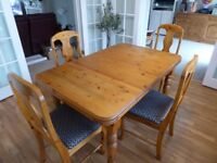 Dining Table (90cm width x 140cm length) with matching 4 chairs. Table extends to 180cm length.