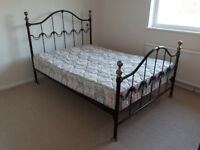 Metal framed bed good condition.Easy to assemble.Brown and gold finish