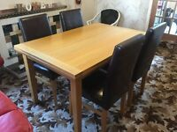 Oak dining table with 4 leather chairs.like new