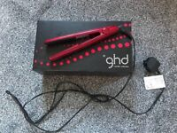 Red GHD hair straighteners