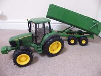 JOHN DEERE TOY GREEN SOUNDS AND LIGHT TRACTOR AND TIPPING TRAILER - 30 INCHES IN LENGTH - OFFERS