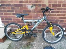 "20"" wheel full suspension mountain bike."