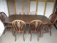 VINTAGE DARK OAK ERCOL STYLE EXTENDING DINING TABLE WITH SIX WHEEL BACK DINING CHAIRS FREE DELIVERY