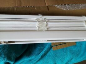 white wooden blind brand new