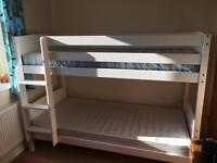 Bunk beds for sale with clean mattresses.