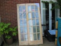 2 new 15 pane pine doors with bevelled edged glass still in wrapping, £50 each. cost £139 each