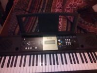 yamaha ypt 220 electric keyboard with stand and music book stand