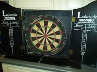 Dart board and wooden case..
