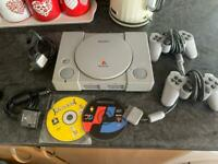 Sony PlayStation1 with two dual shock controllers